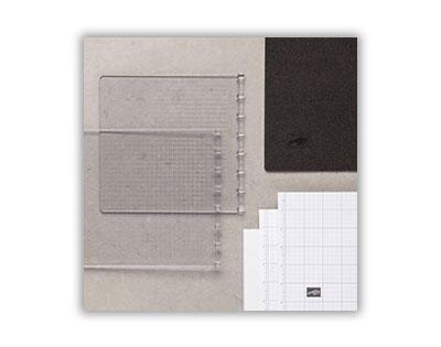 Kombination aus kariertem Papier, Seitenplatten und Schaumstoffmatte für den Stamparatus
